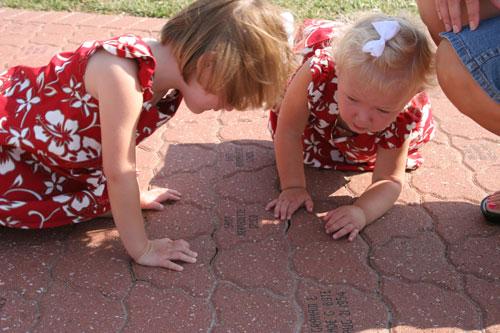 Girls looking at engraved paver