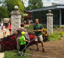 Hort staff talking to Garden visitors-close